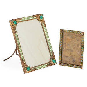 Continental enameled brass frames two one with green and cream details the other with green blue and red design early 20th c the smaller marked larger 9 x 6 14