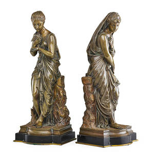 Pair of classical bronze figures female figures resting on a low wall on black onyx base early 20th c unmarked 20
