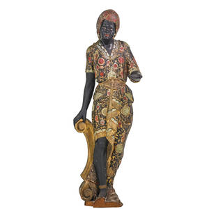 Blackamoor woodcarved statue polychrome decorated woodcarved figure of a woman early 20th c 59 x 20 x 19 12