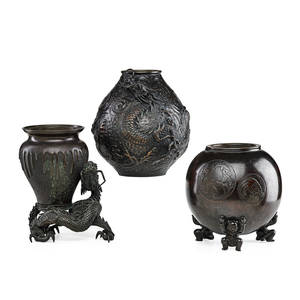 Japanese meiji bronze vessels three one vase with applied dragon one vase with dragon stand and one globular tripod boiler with liner late 19thearly 20th c vases marked 9 12 including st