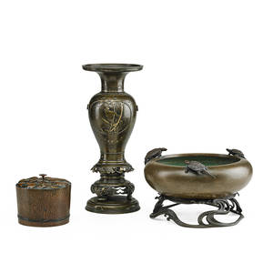 Japanese bronze vessels three one planter with turtles one covered jar with shells and one twopart vase with relief decoration 20th c planter marked tallest 13