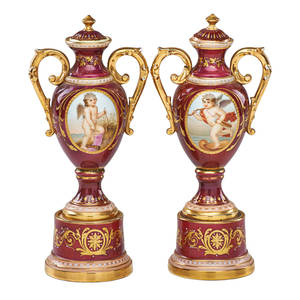 Pair of vienna style porcelain urns handpainted classical reserves on puce ground with gilt decoration early 20th c 9 12
