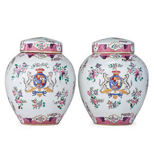 Pair of samson porcelain ginger jars covered jars with central polychrome armorial crest and floral design 19th c marked 11 12