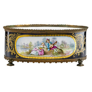 Sevres porcelain centerpiece giltbronze mounted with handpainted reserves of maiden and lyre player on cobalt ground early 20th c marked 6 x 14 12 x 11