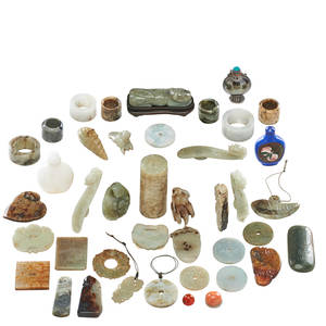 Chinese hardstone and jade articles approximately forty pieces including seven archers rings three snuff bottles four jade belt hooks and assorted hardstone pendants largest 3 12 x 1 12