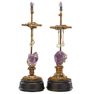 Chinese amethyst and giltwood lamps two carved figures with hanging jade pendants early 20th c 18 14
