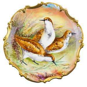 Pair of limoges porcelain chargers one depicting a male pheasant and one female and her brood ca 1900 marked 16 dia