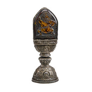 Himalayan silver and amber reliquary buddhist presentation piece with repousse design and amber tablet insert depicting demonic yama late 19th c 16 x 6
