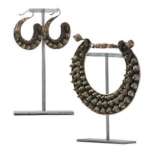 Tibetan style ornamental jewelry two one large metal bib and pair of matching earrings with concentric cones and dragons head with coil neck late 19thearly 20h c bib 10 x 10 12