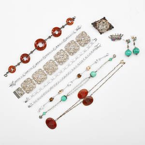 Twelve pieces of jewelry 18902010 19th c includes tinned angel brooch with garnet paste crown brooch carnelian intaglio necklace first half of 20th c includes russet glass and silver link br