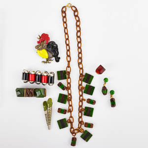 Bakelite and other resinous jewelry eight pieces green bakelite and shaped wood on celluloid link fringe necklace 18 with earrings 34 and similar link bracelet 6 34 bakelite and chromed