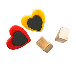 Modern brooches and ear clips four pieces two bakelite heart brooches geometric ear clips