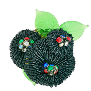 Frank hess for miriam haskell flower brooch flower with red blue green and clear strass centers green pressed glass leaves embossed in plate miriam haskell note pictured in the jewels of miria