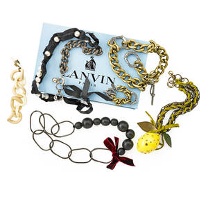 Collection of recent lanvin fashion jewelry six pieces substantial gold and silver tone metal curb link necklace and bracelet with crystal accents crystal embellished resinous lemon pendant with en