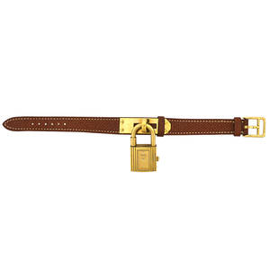 Hermes kelly watch goldplated padlock watch and hardware gold tone face faceted dot hours swiss made quartz movement case 948022 on fawn natural barenia calf strap marked hermes paris acc