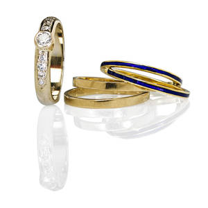 Five gold stacking rings includes diamonds rbc diamond approx 25 ct bezel set with diamond shoulders remaining diamonds approx 18 ct tw marked 14k wg two navy blue enameled bands 18k t