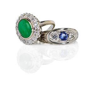 Two white gold gemset rings oval jadeite and diamond cluster ring jadeite 32 cts by formula rbc diamonds approx 70 ct tw in 14k synthetic blue and white sapphires in scrolling engraved 18k