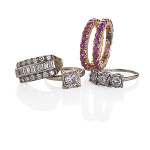 Collection of diamond or gemset 14k gold rings five rings two yg ruby eternity bands size 7 square set solitaire wg engagement ring with round brilliant cut diamond approx 80 ct heart moti