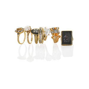 Collection of 14k yellow gold gemset rings seven pieces two prong set natural irregularly shaped river pearl rings carved onyx intaglio ring diamond and sapphire horseshoe ring square set diamon