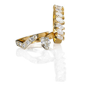 Three 14k yellow gold and diamond rings pear shaped diamond approx 45 ct engagement ring with matching diamond wedding band and marquise cut diamond anniversary band diamonds approx 123 cts
