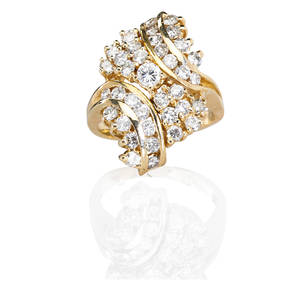 14k yellow gold diamond cluster ring bypass of channel and prong set rbc diamonds center conforming diamond spray largest stone approx 20 ct diamonds approx 2 cts tw ca 1985 marked 14k siz