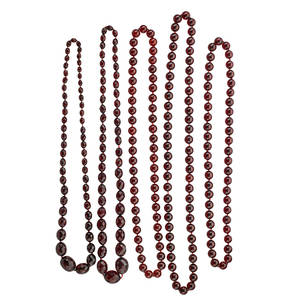 Five strands of bakelite beads to resemble amber three concentric strands of spherical 144 mm cherry bakelite beads longest 34 two graduated strands of oblate faceted bakelite beads 30  9 mm