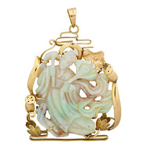 Asian carved opal 14k yellow gold pendant figural carved opal in scenic water lily yellow gold frame 20th c marked 14k 1 34 x 2 12 109 dwt