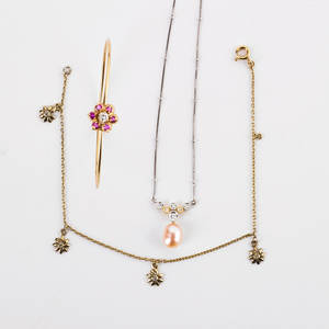 Collection of delicate gold gemset jewelry three pieces 14k yg bangle bracelet with central ruby and rbc diamond closure 14k yg bracelet suspends four daisy charms with diamond centers 18k whi