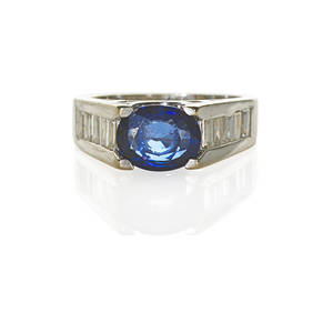 Sapphire and diamond 18k white gold ring by zen oval faceted blue sapphire 188 cts architecturally set to baguette cut diamond channels 1 cts tw ca 2000 marked zen zen diamonds turkey 75