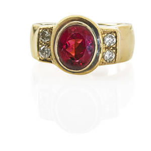 Tourmaline and diamond 18k yellow gold ring oval faceted pink tourmaline approx 24 cts flanked by rbc diamonds approx 40 ct tw in substantial setting late 20th c marked 18k size 9 9