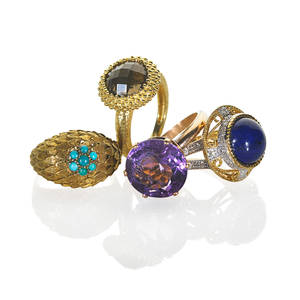 Collection of yellow gold gemset rings four pieces round faceted smoky quartz set in granulated bezel 14k round lapis cabochon in scrolling yellow gold setting with white gold topped diamond acce