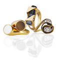 Three artisanal gold diamond hardstone rings bypass with single cut diamond swirl melee approx 30 ct tw bypass with inlaid tigers eye and bone discs geometric design with yg frame encasing b