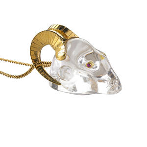 Rock crystal 18k yellow gold ruby ram head pendant carved rock crystal rams head with bezel set ruby eyes conforming textured 18k yellow gold horns that function as bail on associated 18k yellow go