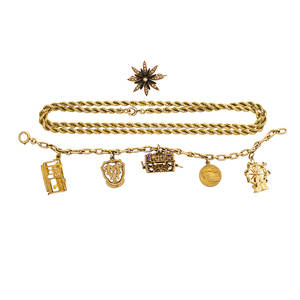 Collection of yellow gold jewelry and charms three pieces rope neck chain 22 12 charm bracelet with treasure box trolley and ferris wheel charms etc victorian enamel split pearl yellow gold