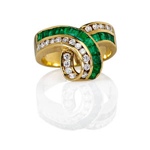 Emerald diamond 18k yellow gold ring channel set calibre cut emeralds approx 97 ct tw and rbc diamonds approx 41 ct tw arranged in continuous loop ca 1985 marked 18k gem weights inscri