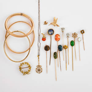 Collection of victorian stick pins and jewelry includes gold twenty pieces stick pins include carved tigers eye moon blue glazed faience scarab faceted aquamarine and diamond micromosaic seed p