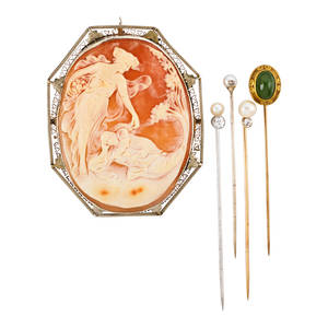 Collection of antique stick pins and cameo five pieces four stick pins one green hardstone and yellow gold three with pearls and diamonds approx 40 ct tw carved shell cameo depicting a fairy
