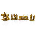 Collection of yellow gold figural groups four pieces cast forms including lion and lioness settlers and native americans woman on horseback etc 20th c one marked 14k shg the rest unmarked
