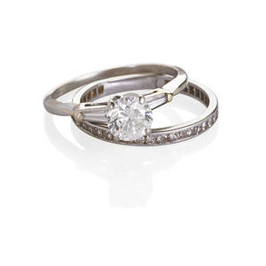 Diamond 14k white gold engagement ring and band rbc diamond approx 117 cts flanked by tapered baguettes in 14k white gold setting with single cut diamond eternity band melee approx 55 ct mid