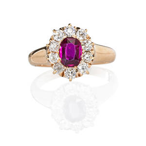 Antique ruby and diamond ring oval faceted ruby approx 54 ct by formula framed by prong set omc diamonds approx 60 ct tw 14k rose gold ca 1900 unmarked size 5 34 27 dwt