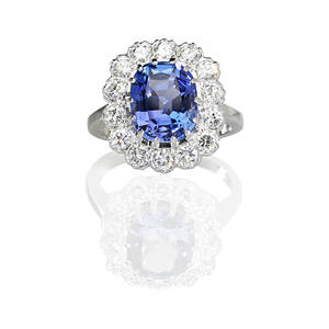 Tanzanite and diamond 14k white gold ring oval faceted tanzanite 625ct by formula surrounded by 14 rbc diamonds approx 15 cts tw 14k wg mount ca 1965 vienna austria gold control mark s