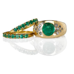 Three emerald and 18k yellow gold rings two prong set emerald bands step cut emerald cabochon approx 35 cts single cut diamonds approx 35 cts tw gypsy ring 20th c marked 18k 750 sizes