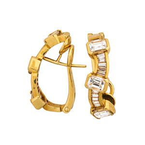 Diamond 18k yellow gold earrings sinuous channel of baguette cut diamonds spaced by step cut diamonds approx183 cts tw in 18k yellow gold post backs for pierced ears ca 2000 marked 750 18k