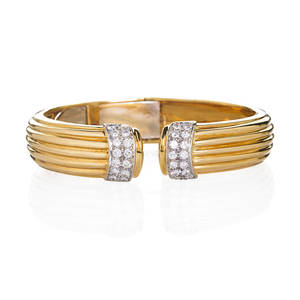 Italian 18k yellow gold diamond bangle bracelet open hinged continuous ribbed design rbc diamond and wg terminals approx 168 cts tw ca 1980 marked 750 with italian control marks 58 x 7