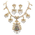 Opal and diamond fringe necklace and earrings 14k yg scroll links suspend ribbon bow and fringe panel the central larger panel supports pear shaped opal 155 cts by formula 113 diamonds in white