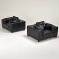 Contemporary pair of lounge chairs 2000s enameled wood stitched leather unmarked 31 x 51 x 42