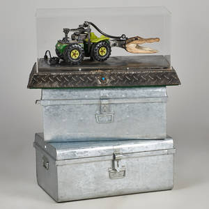 Motorized construction toy tractor with alligator skull and toy man in plexiglass box installed on two metal trunks by unknown artist john carter warload of mars 1993 15 x 23 14 x 17 12