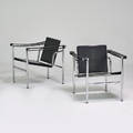 Le corbusier pair of basculant lc1 armchairs 1980s chromed steel stitched leather unmarked 26 x 23 12 x 25