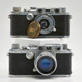 Leica cameras two model f one with a ernst leitz etazlar 115 lenses early  mid 20th c both marked 2 34 x 5 34