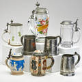 Mettlach steins etc eight pieces including mettlach 2093 deck of cards 12 l mettlach 2211 cameo 310 l steigel type pewter lidded enamel decorated glass stein etc most marked 19th20th